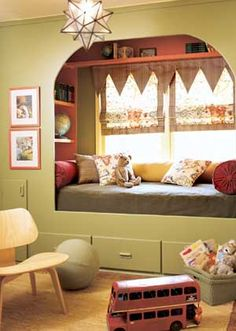 A Boy's Life-- Muted colors are trendy staples for kids' rooms. Give your guy something a little vintage by using softer shades with brown undertones, such as mossy greens and rusty reds. Pages from antique boys' magazines are framed as artwork to keep with the vintage look. This room is kept kid-friendly with fun fabrics, such as those used for the Roman shades and pillows, and plenty of toys.