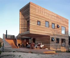 We are used to seeing painted wooden houses in cities or unpainted wood cabins in the forest, but rarely associated this natural material with complex and luxurious modern forms perched high and proud on a hillside. This marvelous mountain home is, therefore, an all the more exciting exception t ...