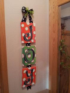 Use shoebox lids or blank canvas from craft store.  Handpaint or Modge Podge scrapbook papers