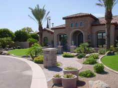 Again, a little rock, pavers, and boulders and you have a simple, low maintenance landscape.