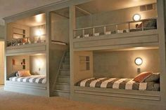 Lighted built-in bunks. Build steps to top bunks for easy access. Tiny home living in your own basement. Bunk Beds Built In, Build In Bunk Beds, Lofted Beds, Bunk Beds With Stairs, Game Room Basement, Basement Ideas, Playroom, Kids Basement, Rustic Basement
