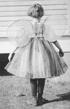 Little girl in butterfly wings, vintage photo.