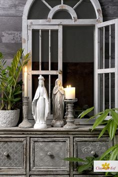 DRESSOIR STYLING • We love to combine al kinds of grey! Collection: Mary statues, dressoir, candles, pots and windows. Statues, Home Accessories, Oversized Mirror, Pots, Mary, Windows, Candles, Living Room, Furniture
