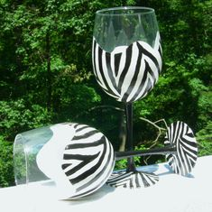 Black and white wine glasses. Walk on the wild side. Dramatic black and white painted zebra stripes all around the glass. Great as a birthday