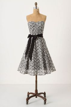 Maybe with a crinoline that's just a little bit longer, to allow a hint of color...? ($188 #Strapless #Dress #Flowers #Pattern #Black #White #Bow)