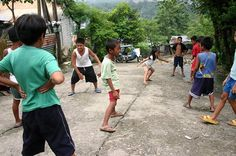 Patintero is a children's game usually played on empty streets, schoolyards and beaches. It involves a grid drawn on the ground where one team will try to pass through while the opposing team tries to catch them without leaving the grid's lines at all times.