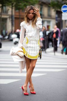 Erica Pelosini in a white button-up + Balmain miniskirt + red heels