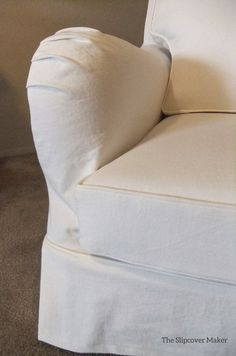 Cottage-style slipcover custom made in washed white denim.