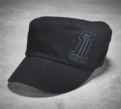 9fc7a7988e0 Men s Flat Top Cap    cotton. Cotton lining. Raw-edge embroidered patch on  front. Embroidered graphics on back. Bar   shield logo adjustable back  closure.