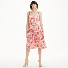 With a breezy pleated skirt, structured bodice, and delicate ladder stitching, the Sinthea epitomizes modern femininity. Here, a timeless red French toile print makes it an especially striking choice for all of your warm-weather occasions. Polyester  Straight fit 45½' in length, based on a M Sweetheart neckline with shoulder straps; structured bodice; ladder stitching details; pleated skirt; concealed back zip with hook-and-eye cl