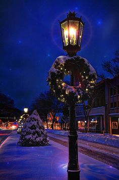 Gas Mantle Kronberg lamps lining the city streets of Wellsboro, PA, decorated for the holiday season.