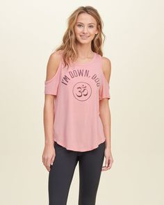 Effortless with shoulders cutout, graphic printed with faded effect at front, curved hem and a crewneck