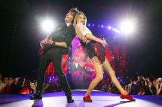 That's what friends are for. Current GRAMMY nominee Taylor Swift  leans on her guitarist Paul Sidoti during a performance on Dec. 14 in Melbourne, Australia