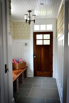 Cool mudroom, shingles on inside of room+ good lighting-windows& transim (sp?)-gives an inside/outside feel, love the wood door