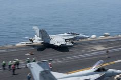 """ARABIAN GULF: An F/A-18F Super Hornet, assigned to the """"Jolly Rogers"""" of Strike Fighter Squadron (VFA) 103, launches from the flight deck of aircraft carrier USS Harry S. Truman (CVN 75). (U.S. Navy photo by Mass Communication Specialist Seaman Anthony Flynn/Released)"""