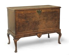 Tennants Auctioneers: A George II Walnut and Featherbanded Chest on Stand