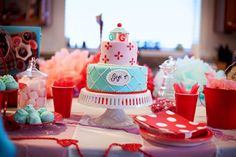 Love the color scheme of this baking party for little girls. The girls were given cute aprons, chef's hats and play rolling pins to take home after baking and decorating cookies. Even we big girls could enjoy a party like this.