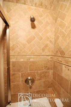 Travertine Shower w/ large subways in oversized herringbone pattern...