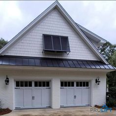 """Add exterior garage door lights for style and home security. Add garage door windows to brighten up the interior of your garage space as well.   """"What Homeowners Need To Know About Garage Doors in 2021"""" by ProLift Garage Doors Blog"""