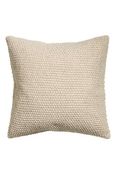 Housse de coussin: Housse de coussin au point de riz avec envers en coton tissé. Fermeture à glissière dissimulée.