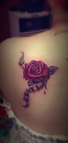 A gorgeous bleeding rose tattoo on the back.