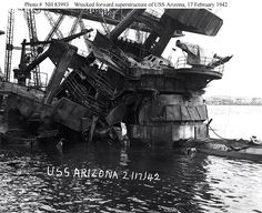https://flic.kr/p/e9uZUj | USS Arizona (BB-39) Salvage 1942, Pearl Harbor | USS Arizona (BB-39) Photo #: NH 83993 View of the sunken battleship's forward superstructure, showing damage caused when her forward magazines exploded during the 7 December 1941 Japanese raid on Pearl Harbor, Hawaii. The photograph was taken on 17 February 1942, as work began to remove the collapsed wreckage. The crane in the left background was then removing Arizona's mainmast.  Courtesy of the Naval Historical…