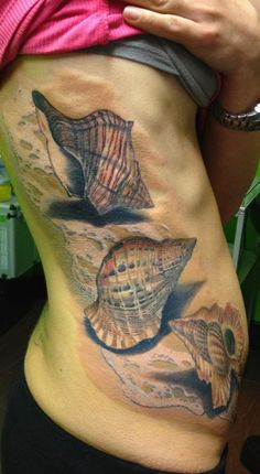 Tattoo by Matteo Pasqualin - I like the sand with the white caps of the water over it. very neat detail