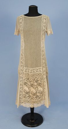 EMBROIDERED NET SUMMER DRESS, 1920's. Ivory short sleeve with woven vertical stripe inset with bands and panels of floral embroidered net.