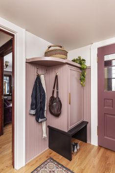 """The renovation of a Victorian-era home in Portland, Oregon, included updating the entry area with new storage and a muted pink hue, picked in collaboration with the client. """"She wasn't afraid of color,"""" says Stephanie Dyer of Dyer Studio, who paired it with a deeper burgundy shade for the doors. #dwell #howtodesignwithpink #pinkdecorideas #interiordesign #moderndesign #pink #entryway Dusty Pink Bedroom, Pink Tiles, Blue Backsplash, Deep Burgundy, Mudroom, Modern Design, Type Design, Kitchen Remodel, Entryway"""