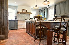 Custom kitchen cabinets and island using Real Milk Paint, hand-forged hinges, restoration glass and barnwood elements