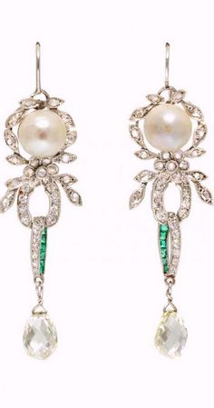 A Pair of Platinum, Pearl, Emerald and Diamond Earrings, containing two pearls (origin not tested) measuring approximately 7.00-7.10 mm in diameter, 12 calibre cut emeralds, two briolette cut together with numerous single and rose cut diamonds weighing approximately 3.12 carats total.