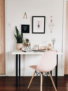 Small chic at home desk space with minimalist interiors and gallery wall.