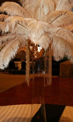 mask, feather, bead centerpiece for masquerade show