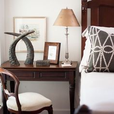 One of my favorite ways to style the buffalo horn is standing them up. Don't they look proud?  Here they add a masculine touch to a sophisticated guest room. They draw your eye up and are an unobtrusive layer in front of the artwork. #thepaintedolive #horndecor #buffalohorn #theexoticcollection