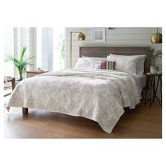 Neutral colors blend well with texture, such as in the Cream Palm Stitch Quilt from Threshold. This quilted bed cover highlights bold palm fronds for a tropical feel in an easy-to-match color.