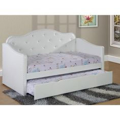 This twin trundle bed is a great addition to any bedroom! Upholstered with faux leather, this bed is a perfect addition to any bedroom. The pull out trundle offers additional sleeping space, and spacious drawers provide plenty of storage space. Due to its platform design, no boxspring is needed. **Mattress not included, but available for additional purchase.** Dimensions:89 x 44 x 39H