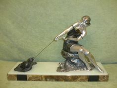 Unusual French spelter figure signed by 'Rochard'. She is a lady playing with a seal.