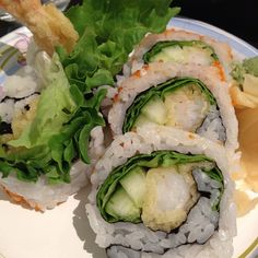 Shrimp tempura roll   whole gr rice carrots shrimp or crab avacado, spinach cucumber w/ spicy mayo or ginger honey