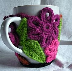 Mug cozy pieced w/crochet flowers and leaves ~ wonderful way to use new pattern experiments and mixed yarn weights Crochet Mug Cozy, Love Crochet, Crochet Flowers, Knit Crochet, Easy Crochet, Yarn Projects, Crochet Projects, Crochet Gratis, Freeform Crochet