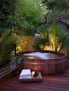 Large cedar wood hot tub.