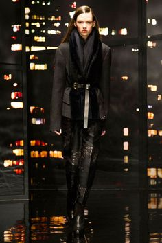 Rather than sling a scarf around your neck, take cues from Donna Karan and incorporate it into your look with a belt.   - HarpersBAZAAR.com