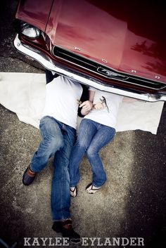workin on the mustang engagement session | engagement session with props | kaylee eylander photography | seattle wedding photographer  On my gosh, freaking adorable. Want this, hopefully my man works with cars :)