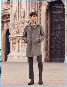 French model Arthur Gosse steps out in slim trousers and a check single-breasted coat by Eleventy.