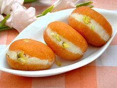 Chum chum is a spongy Indian sweet dish. The chum chum or chom chom is made with homemade cheese or paneer. It is a popular Bengali sweet dish that can be made in different colours. Indian Dessert Recipes, Indian Sweets, Indian Snacks, Sweets Recipes, Indian Recipes, Holi Recipes, Diwali Recipes, Dishes Recipes, Easy Recipes