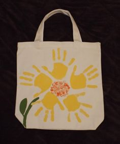 This makes a great gift for Mother's Day, grandparents or for that someone who needs a little sunshine in their life. Little hands were used to make the petals and thumb prints were used for the center.  We had a lot of fun creating this tote bag and shared lots of giggles when it tickled putting the paint on the little hands. :-)