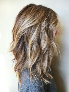blonde and light brown wavy beach curled hair. /
