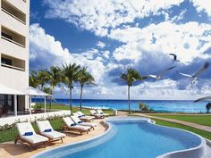 Poolside sun loungers at Dreams Cancun