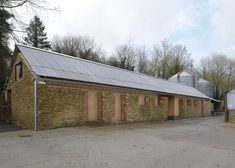 Hugh Strange Architects transformed an agricultural barn in Somerset, England, into a family archive building.