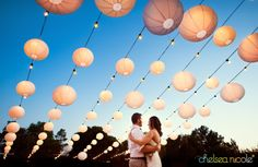 Lanterns over the dance floor by Layers of Lovely Floral Design at Legends Ranch