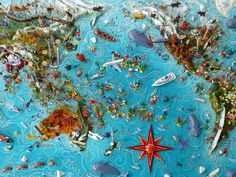 Sara Drake - Pacific centred world map  Maps are made from mixed media, including papier mache, balsa wood, acrylic paint, beads and wire. All details are hand made and to commission. Each map is personalised with the details of the client's own travels.
